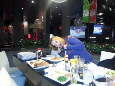 Dani with a variety of yummies at Dave & Buster's