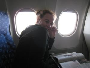 Dani in airplane going to Cancun