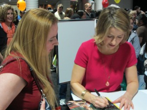 Samantha Brown signing an autograph for Dani