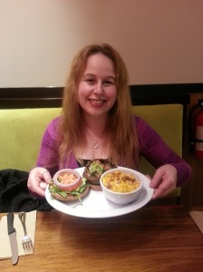Dani with her Papa's Portobello Sandwich & Vegan Mac & Cheese