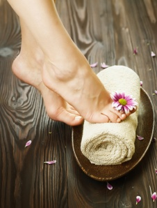 Beautiful Woman Feet with flower.Spa or pedicure concept
