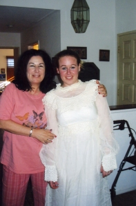 Mom trying to dress me in her wedding dress in 2002