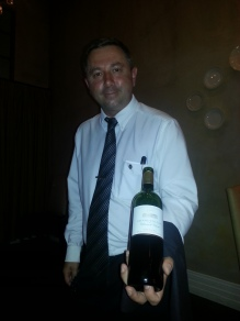 Sommelier Francois Franky with a bottle of Bordeaux - Grand Enclos du Chateau de Cerons 2005