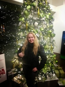 Dani in front of Christmas tree in OC Mix