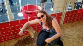 Dani makes a deer friend in the petting zoo
