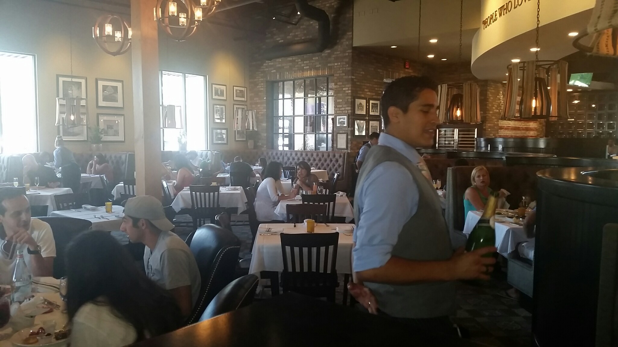 Our fabulous waiter alexander making his rounds brunch for Taps fish house irvine