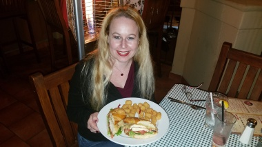 Dani with Sky Ranch Chicken Sandwich with Tater Tots - Sky Ranch Saloon at Ruby's