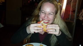 Dani gobbling up her Sky Ranch Chicken Sandwich - Sky Ranch Saloon at Ruby's