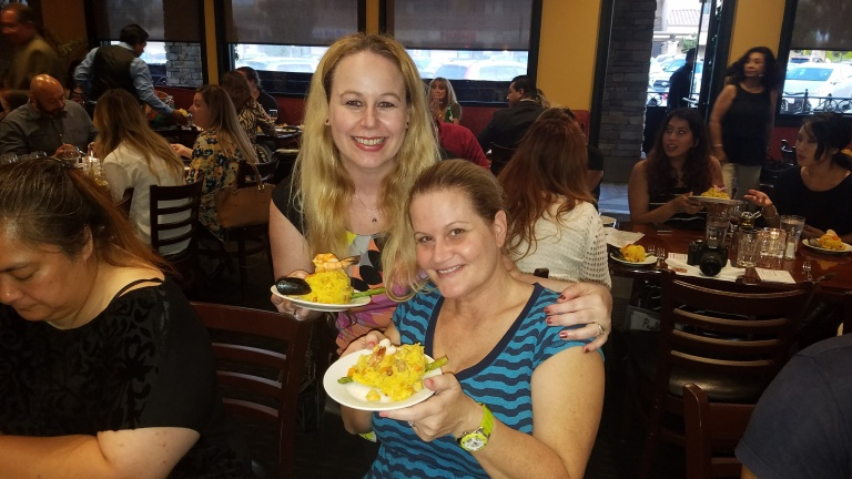 With my friend enjoying paella at Villa Roma - Paella Wine and Beer Festival